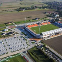 Śmieszne Historie o Piłce Nożnej w Polsce: Introducing Bruk-Bet Termalica Nieciecza, Europe's Smallest Ever Top Flight Football Club - Copyright - https://www.bruk-bet.pl/public/images/parking-i-stadion-bruk-bet-termalica-nieciecza.jpg